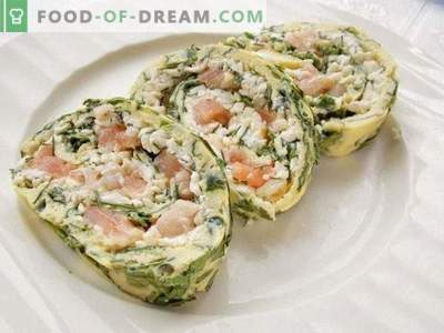 Omelet roll stuffed with cheese, red fish and greens