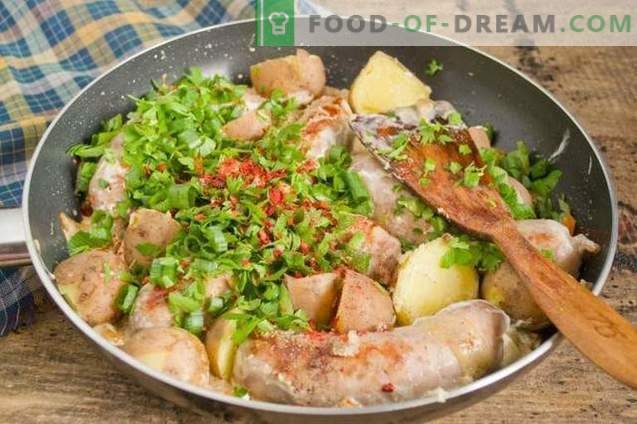 Fried sausage in a pan with country-style potatoes