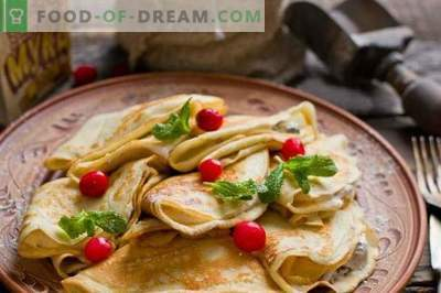 French crepes. Thin pancakes with prunes and curd