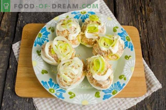 Eggs stuffed with herring and melted cheese