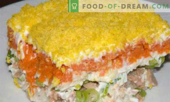 Salad with canned fish, recipes with apple, carrots, crackers, mushrooms, beans