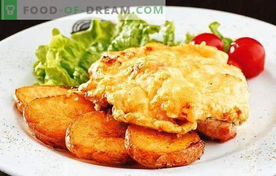 Pork chops with tomatoes and cheese - juicy! How to cook