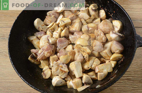 Roast with pork and mushrooms in a pan - a man will say