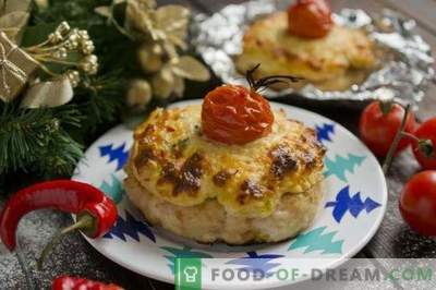 Cutlets with topping and cherry tomatoes in the oven