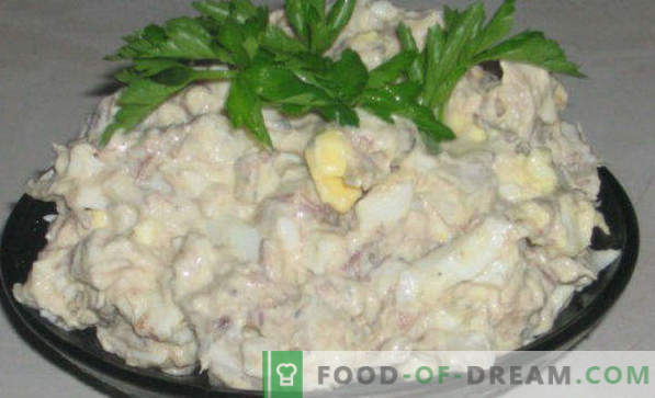 Delicious recipes for salads from canned fish, with melted cheese, Gentle, Sunflower, Mimosa