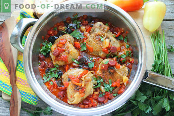 Cooking chicken in Spanish: with tomatoes, wine and smoked sausages