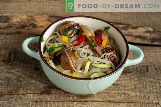 Warm salad with funchoza, beef and mushrooms