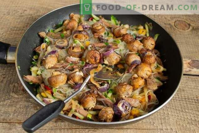 Warm salad with funchoza, beef and mushrooms